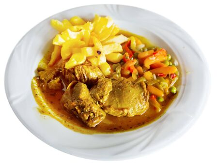 Image of baked pork cheeks in  sauce with potatoes and vegetables served on plate. Isolated over white background