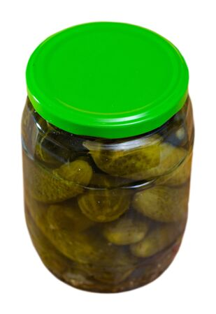 Image of glass jar with pickled cucumbers. Isolated over white background