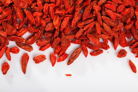 Closeup of dried goji berries on white background. Concept of healthy food Stock Photo