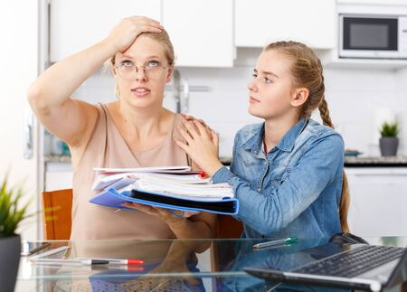 Mother very dissatisfied with poor in studies of her teenage daughter Фото со стока