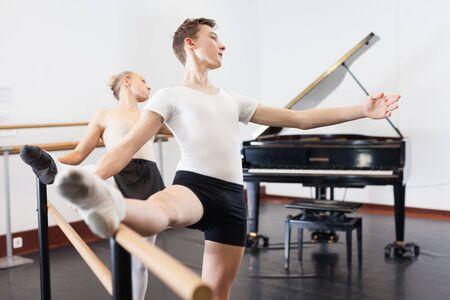 Choreographer teaches a ballet lesson in the studio Banco de Imagens