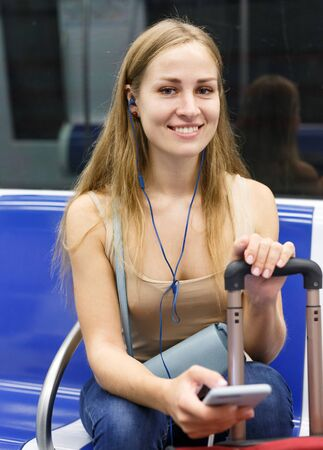 Young woman traveling on underground and listening music with headphones Stock Photo