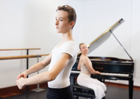 Ballet lesson in the studio. Choreographer plays the piano Banco de Imagens