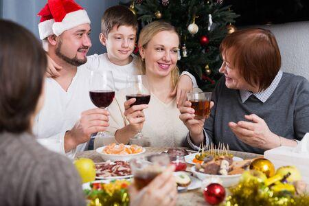 Big happy family celebrating Christmas, enjoying dinner at home