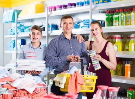 happy american couple and teenager with household goods purchase in the store Stok Fotoğraf - 128758327
