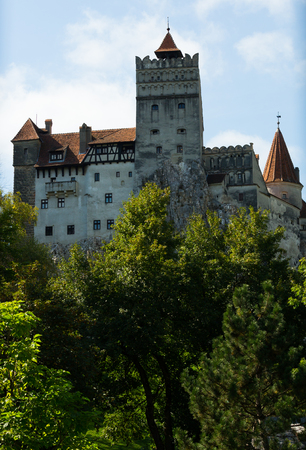 View of Bran Castle on cliff top, historically serving as strategic defensive fortress, Romania Editorial