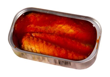 Canned sea fish, mackerel fillets in tomato served with herbs and lemon. Isolated over white background