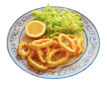 Crispy squid rings in batter Roman style. Traditional spanish dish. Isolated over white background