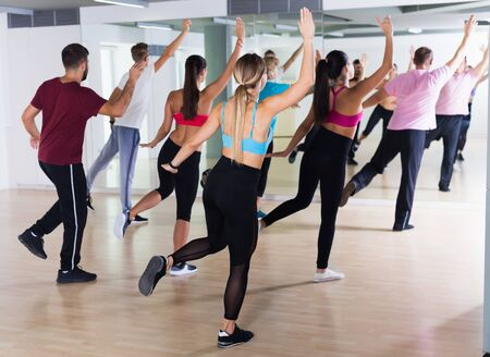 Active women and men of different ages dancing in  modern studio Stock Photo - 128832459