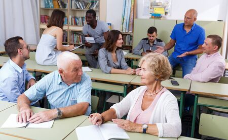 Mature man and woman talking during exam in the classroom Stockfoto