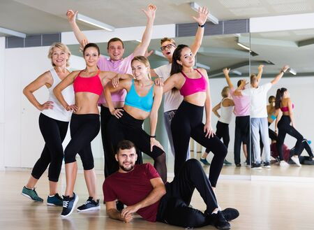 Adult males and females dancing excited posing in studio Stock Photo - 128832870