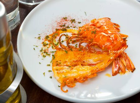 Seafood dish. Delicious spicy grilled cut shrimps on white dish Reklamní fotografie