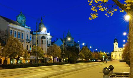 Picturesque cityscape of Debrecen streets with Great Protestant Church in night lights, Hungary