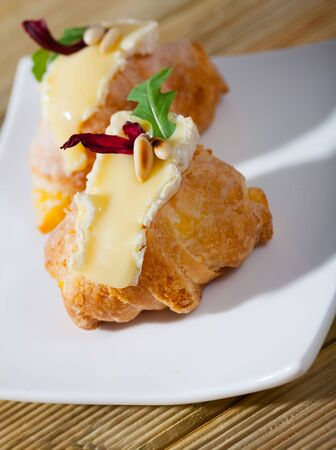 Mini croissant with Camembert, arugula and roasted pine nuts