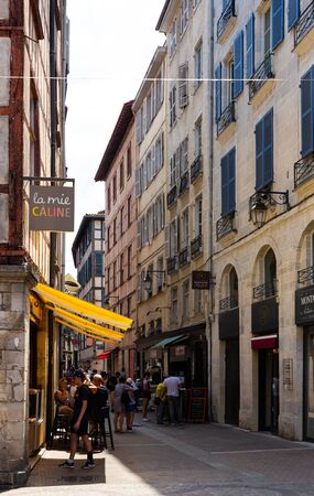 BAYONNE, FRANCE - JULY 17, 2019: Traditional architecture of Bayonne old narrow streets
