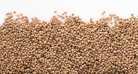 Healthy and nutritious food, dry raw lentils on white background