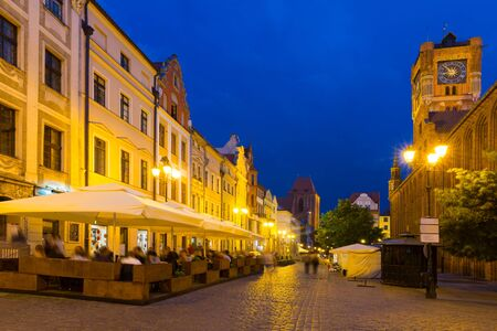 Night view of Torun streets and building illuminated at dusk, old town in Poland Reklamní fotografie
