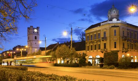 View of night streets of Debrecen with Small Reformed Church, Hungary