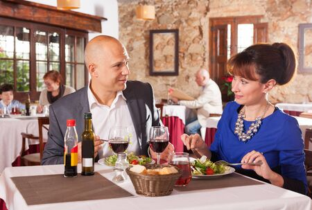 Portrait of glad couple having romantic dinner in restaurant Zdjęcie Seryjne