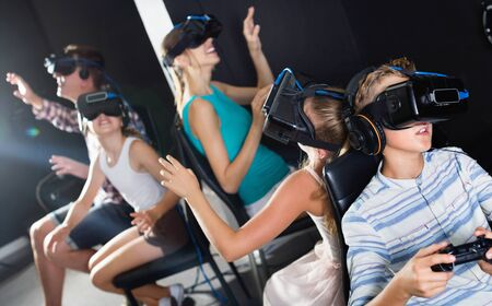 Positive smiling family of five is watching VR together in the room. Banque d'images