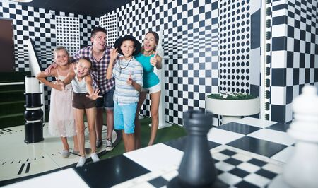 Young family is satisfied of visit together of lost chessroom.