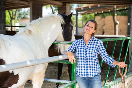 Owner of a horse farm shows her farm