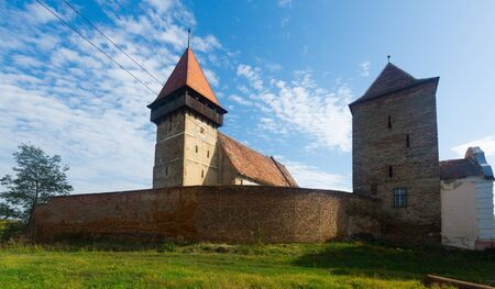 View of medieval fortified church of Brateiu, Romania