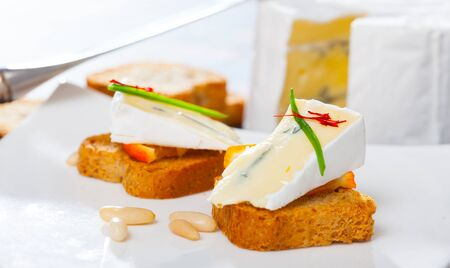 Tasty canape with soft blue cheese and orange Stok Fotoğraf