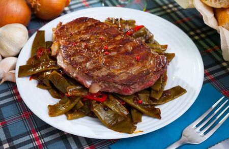 Steak beef with stewed green beans and pepper