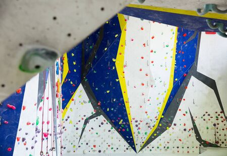 View of interior of empty modern climbing hall for mountaineer training