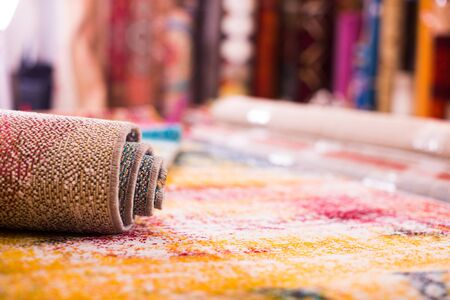 Image of colorful wool carpets for sale at showroom,  no people