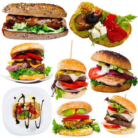 Sabrosas hamburguesas con queso, sándwiches y otros platos de comida rápida aislados sobre fondo blanco