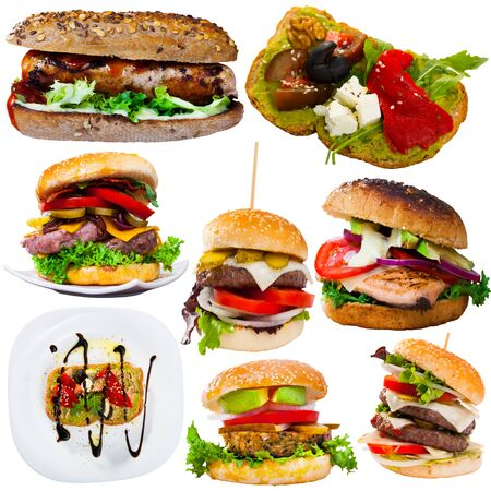 Tasty cheeseburgers, sandwiches and other fastfood dishes isolated on white background