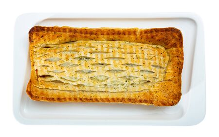 Traditional salmon in puff pastry. Isolated over white background