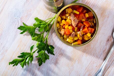 Milanese tuna salad with corn and boiled carrot in tin can, nobody