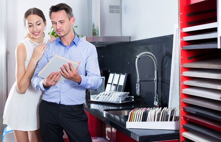 Married couple looking for stylish kitchen fronts in furniture store Stok Fotoğraf