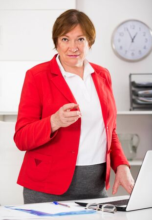 Smiling woman manager waiting for clients in her office Stock fotó