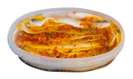 Preserved sea fish, marinated sardines or herring. Isolated over white background Фото со стока