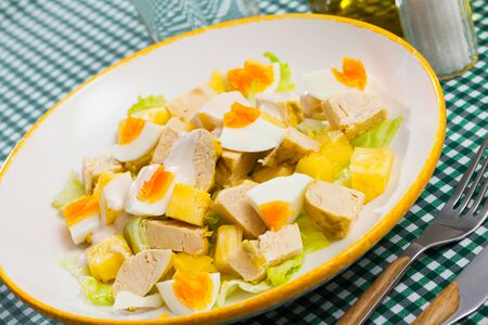Tasty salad with chicken,  egg and sweet pineapple at plate Zdjęcie Seryjne