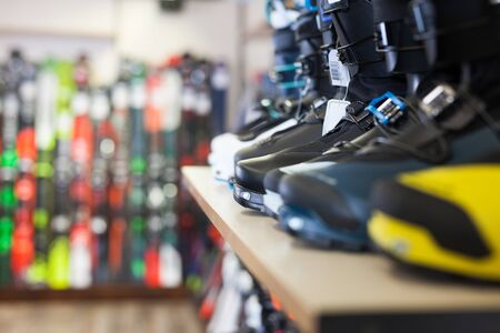 Sport equipment store interior with large assortment of modern ski boots