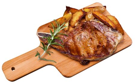Appetizing beef steak with potatoes and rosemary. Isolated over white background