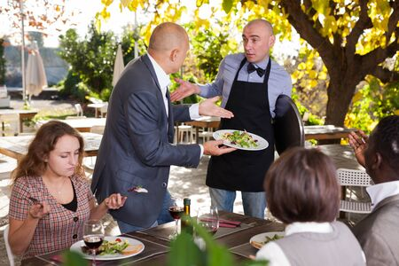 Restaurant guests complain about the food to the waiter Stock fotó