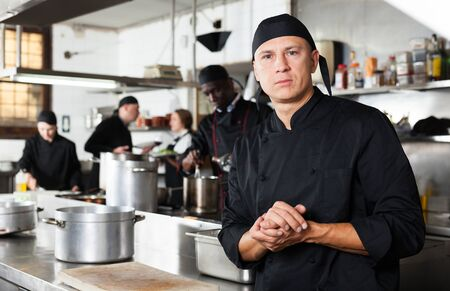 Professional male chef in kitchen of restaurant