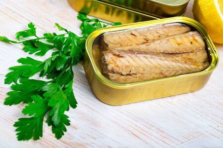Picture of tasty fillet of mackerel  in sunflower oil in open tin can Stock Photo