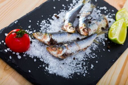 Picture of  deliciously dish of anchovy baked in the oven on a pillow of sea salt