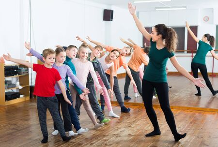 Boys and girls studying contemp dance in dancing studio 写真素材
