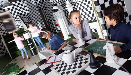 Exciting adventure for glad cheerful smiling kids in chess quest room