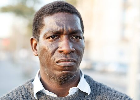 Portrait of bewildered adult African-American man in woolen sweater