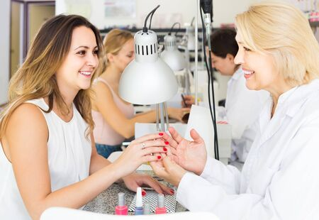 lovely russian  female clients doing nails in nail salon in afternoon Stockfoto