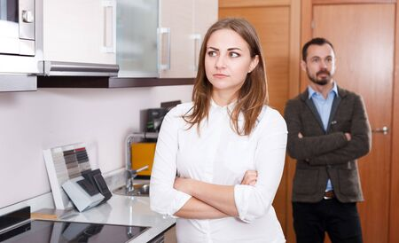 Upset girl disagreed with her husband in choice of materials for kitchen furniture in salon